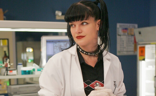 Pauley Perrette as Abby Sciuto working in the lab on NCIS
