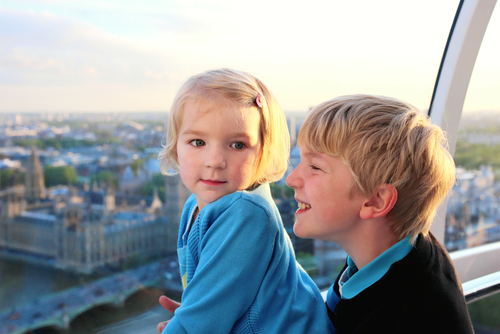 two children enjoying the view of London from inside a skyscraper