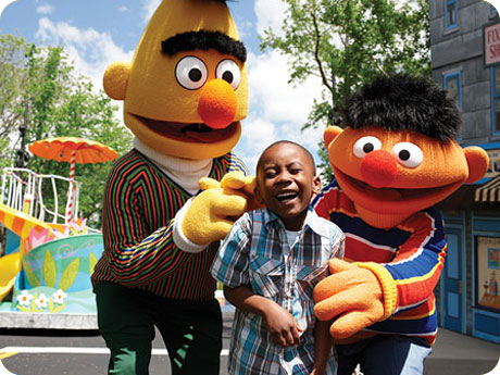 boy with adults in Bert and Ernie costumes