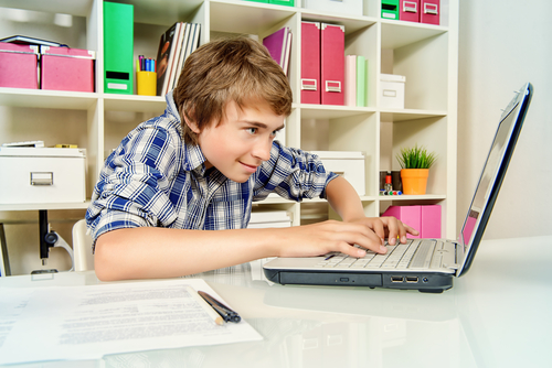 boy studying on laptop