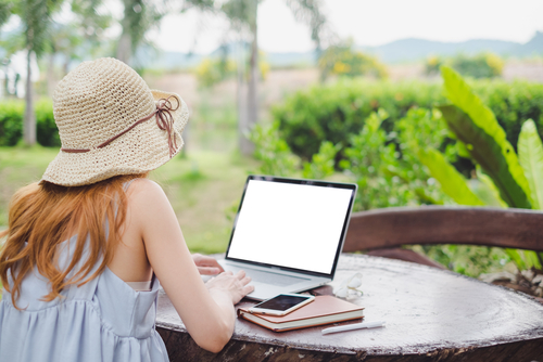 girl studying outdoors with laptop